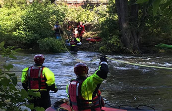 kent fire department at a river rescue